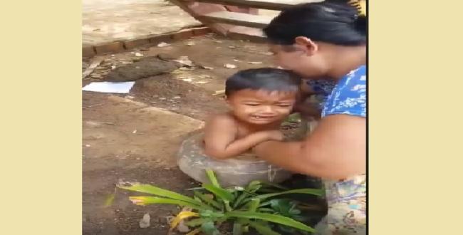 child struggled inside pot