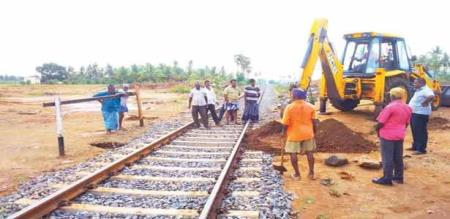 A TRAIN ACCIDENT IS PREVENTED BY A VILLAGE PEOPLES