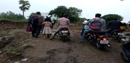 people struggling for road damaged