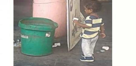 in rajapalayam a child clean waste cup in bus stand for waiting kampam bus