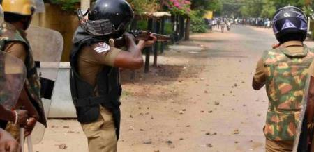 police firing on villagers