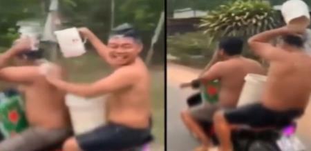 bathing on driving bike police punished