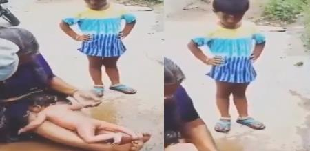a cute girl tells her grand ma when bathing her little new born baby
