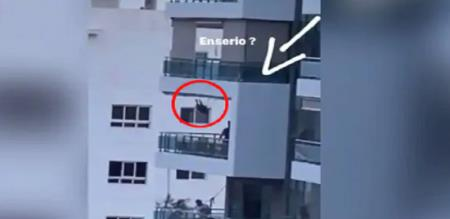 Island father swing baby in balcony at dangerous level