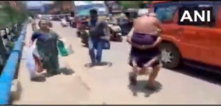 Kerala man carries 65 age old father to hospital when police stops auto before 1 km