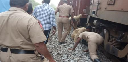 north indian old lady stuck under train