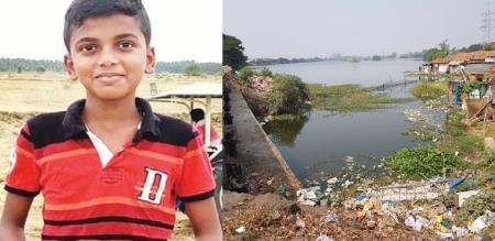 small boy helps to clean lake in tanjavur