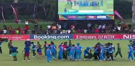 players fight in ground after match
