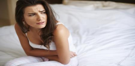 stomach pain on periods