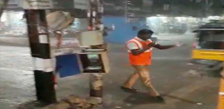 traffic police officer does his work on rain