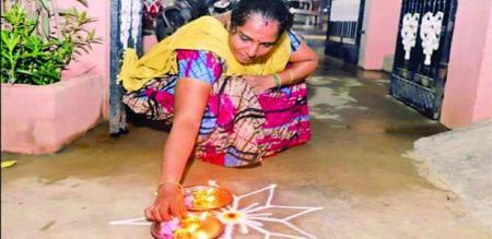 Women pray with lights to protect from Corona