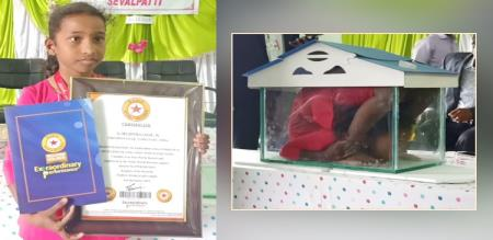 9 years old girl yogasanam in small glass box