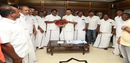 One of the important person DMK tied the bow